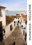 narrow street in spain | Shutterstock . vector #402162448