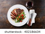 sliced medium rare grilled beef ... | Shutterstock . vector #402186634