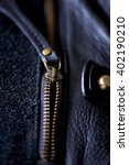 Small photo of ajar the zipper on a leather bag