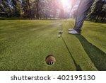 Golf Putting In Green