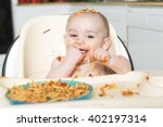 a little b eating her dinner... | Shutterstock . vector #402197314