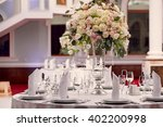 table setting at a luxury... | Shutterstock . vector #402200998