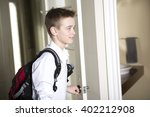A Teen Coming Home Passing...
