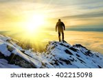 Stock photo the man to stand on mountain top at sunrise 402215098