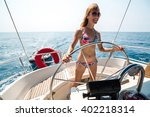 young lady at the helm of a... | Shutterstock . vector #402218314