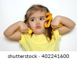cute little girl with yellow... | Shutterstock . vector #402241600