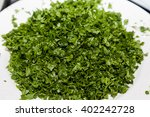 closeup of chopped parsley with ... | Shutterstock . vector #402242728