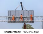workers install big steel... | Shutterstock . vector #402243550
