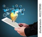 businessman holding a tablet ... | Shutterstock . vector #402278980