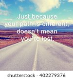 """Small photo of Inspirational life quote with phrase """"just because your path is different, doesn't mean you're lost"""" with retro style background."""