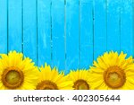 Sunflower On Blue Old Wood