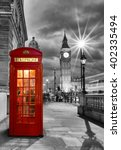 Red Telephone Booth In Front O...