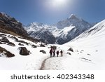 trekker hiking to the mountains.... | Shutterstock . vector #402343348
