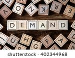 Small photo of the word of DEMAND on building blocks concept