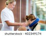 woman receiving massage in... | Shutterstock . vector #402349174