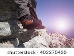 a traveler stands on top of a... | Shutterstock . vector #402370420