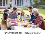 happy family having lunch in... | Shutterstock . vector #402384190
