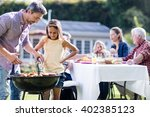 father and daughter at barbecue ... | Shutterstock . vector #402385123