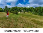 man with red shirt in field | Shutterstock . vector #402395080