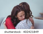 depressed woman embracing her... | Shutterstock . vector #402421849