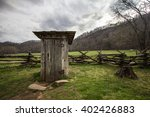 Wooden Outhouse In The Smoky...