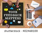 Small photo of YOUR FEEDBACK MATTERS Businessman working at office desk and using computer and objects on the right, coffee, top view