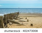 Wooden Groynes Pillers At Beac...
