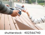 woman pay with cellphone at... | Shutterstock . vector #402566740