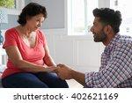 adult son comforting mother... | Shutterstock . vector #402621169