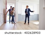realtor showing hispanic couple ... | Shutterstock . vector #402628903