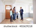 realtor showing hispanic family ... | Shutterstock . vector #402629218