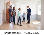 realtor showing hispanic family ... | Shutterstock . vector #402629233