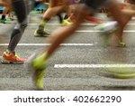 Runners Feet On The Road In...