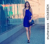 teenage girl runs along the... | Shutterstock . vector #402683824