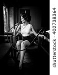 young  beautiful woman smokes a ... | Shutterstock . vector #402738364