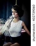 young  beautiful woman smokes a ... | Shutterstock . vector #402739060