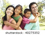 young family having fun in park | Shutterstock . vector #40275352