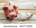 piggy bank and energy saving... | Shutterstock . vector #402771850