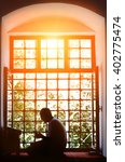 bearded man praying in the... | Shutterstock . vector #402775474