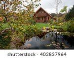 Small Pond With Wood House .
