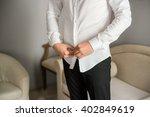groom fees. man buttons shirt.   Shutterstock . vector #402849619