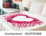 Stock photo white pillow and red rose flower on bed decoration in bedroom interior vintage light filter 402909388