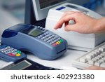 hand of woman using payment... | Shutterstock . vector #402923380