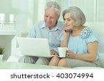happy senior couple with laptop | Shutterstock . vector #403074994