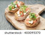 homemade bruschetta with cheese ... | Shutterstock . vector #403095370