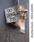 dirty water tap  with a warning ...   Shutterstock . vector #403118344