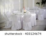 table with chairs covered and... | Shutterstock . vector #403124674