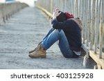 young homeless boy sleeping on... | Shutterstock . vector #403125928