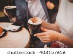 bride and groom holding coffee...   Shutterstock . vector #403157656