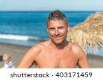 man relaxing on a beautiful... | Shutterstock . vector #403171459